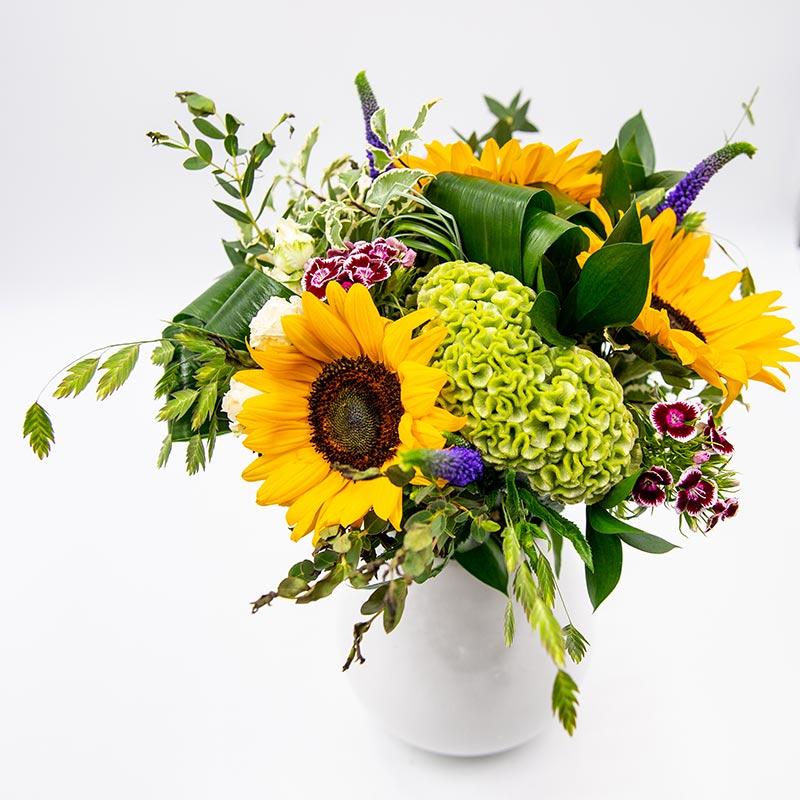 Saveurs estivales Bouquet rond composé de tournesols
